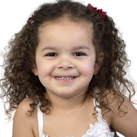 Adorable smiling mixed race toddler girl at a Preschool & Daycare Serving Toledo, OH