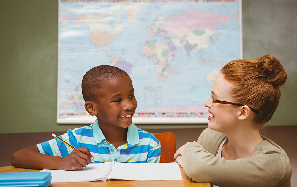 teacher and boy tutoring at a Elementary School Serving Toledo, OH