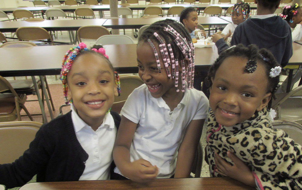 three smiling girls at a Preschool & Daycare Serving Toledo, OH