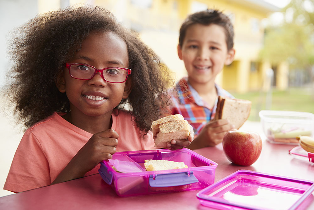 young kids eating their packed lunches at a Elementary School Serving Toledo, OH